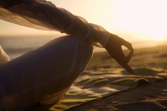 Woman Meditating on Beach --- Image by © Hannah Mentz/Corbis